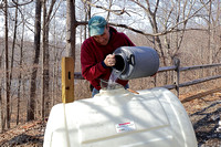 170223_0486_EOS M5 Teatown Volunteer Rudy Fasciani Fills the Sugar House Supply Tank with Sap Collected from the Sugar Maples